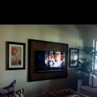Frame for a wall mounted TV