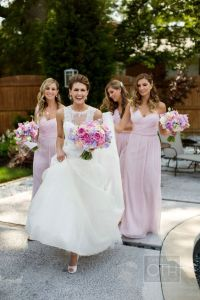 Beautiful bride and bridesmaids! Love their color ...