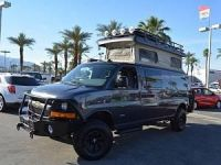 Chevy Express van with Aluminess bumpers, ladder and roof ...
