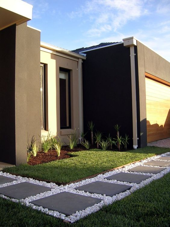 Modern Front Yard With Grasses Pavers And Pebbles Gardening