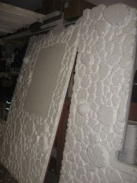 Styrofoam Faux Stone Wall... this is pretty neat idea