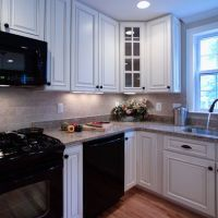 Black Refrigerator White Cabinets on White Kitchen With ...