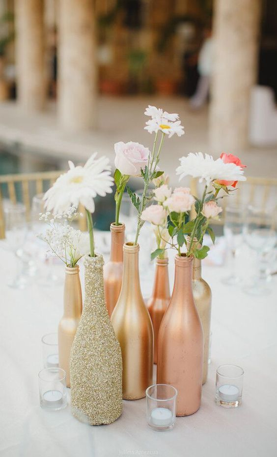 boho glitter bottles and flowers wedding centerpiece / http://www.deerpearlflowers.com/unique-wedding-centerpiece-ideas/2/: