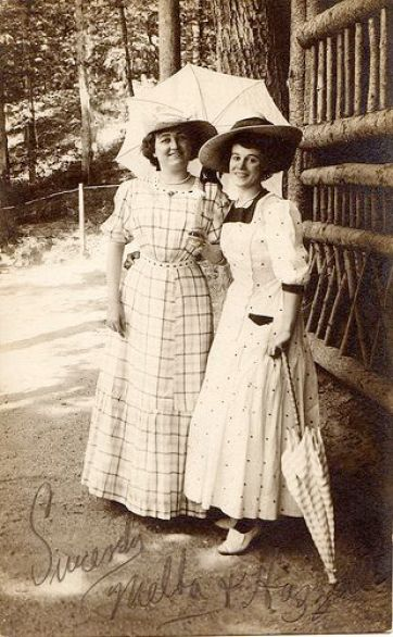 Two women with parasols, circa 1910...love the dresses!: