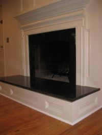 Raised paneled fireplace with granite surround and hearth ...