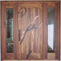 Beautiful koa wood custom door with metal inlay work in ...