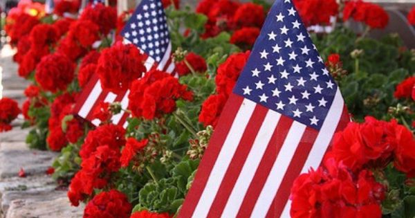 Flags and Flowers at The Dillard House  Red geraniums and