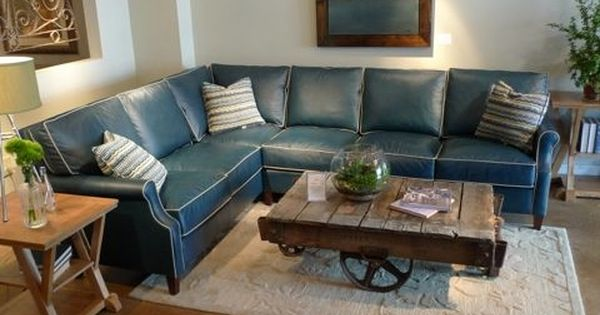 blue leather sectional with contrast white piping