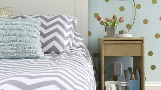 Girls bedroom in aqua gray white and gold color palette with feature wall painted in Sherwin