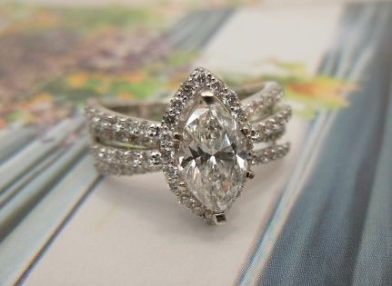 Heres a stunning engagement  wedding ring setting to make a Marquise diamond look modern and