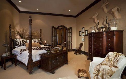 Furniture, bed, bedroom, room, bookcase, interior design, shelving, shelf. paint savanna bed brown. dark wood trim..zebra! plant