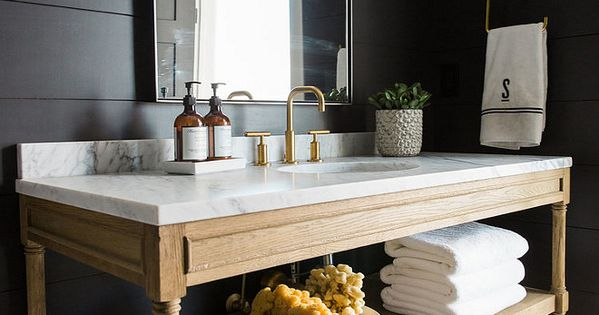 Bathroom with reclaimed wood vanity white marble countertop cement tiles and shiplap walls