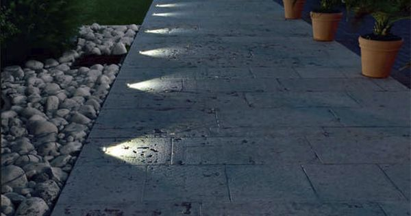 Recessed in ground lighting suddenly turns this pathway into a nightime feature  Lighting