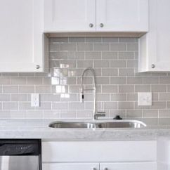 Inexpensive Countertops For Kitchens Cost To Remodel A Kitchen Smoke Gray Glass Subway Tile, White Shaker Cabinets, Pull ...