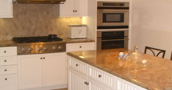 white kitchen cabinets, travertine tile floors