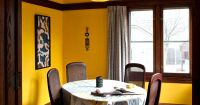 dining room, bright yellow walls with beige ceiling, dark ...