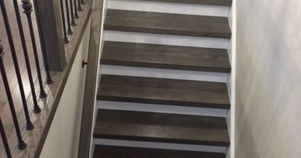 Greybrown tones on staircase with white risers and