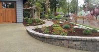 Landscaped Yard With Curved Paver Sidewalk & Retaining ...