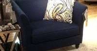 Navy blue chair and a half. This has a matching sofa and ...