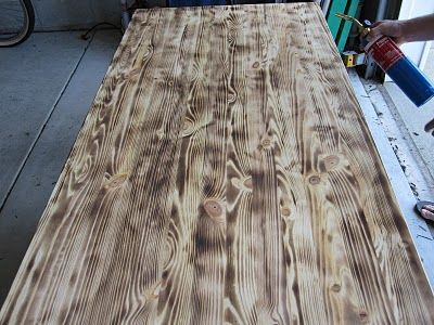 Unfinished pine Ikea table top you can use a blow torch