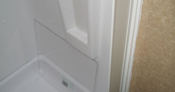 Rockwood Roo 233s shower mod Added a Magic White Splash Guard from Lowes to prevent water from