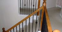 mixed iron balusters with wood railing | Bi-level home ...