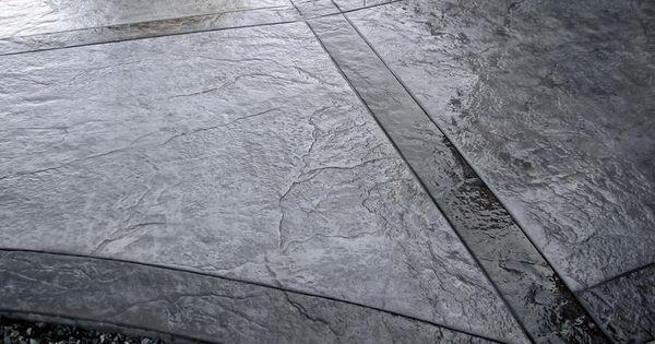 stampedtexture concrete patio gray with black  Grey