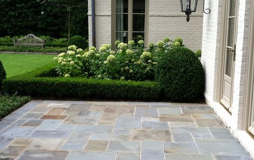 Easy DIY Patio Ideas  Boxwood hedge Stone patios and