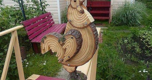 Really cool rooster made from log wood slices