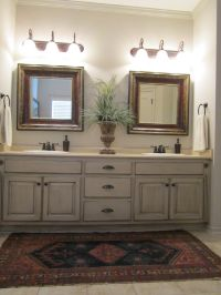 Painted and antiqued bathroom cabinets.