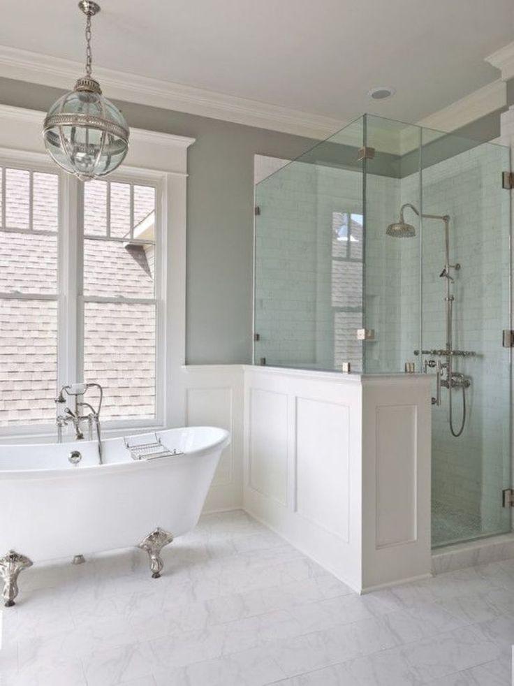 Airy bathroom with white silver clawfoot bath tub