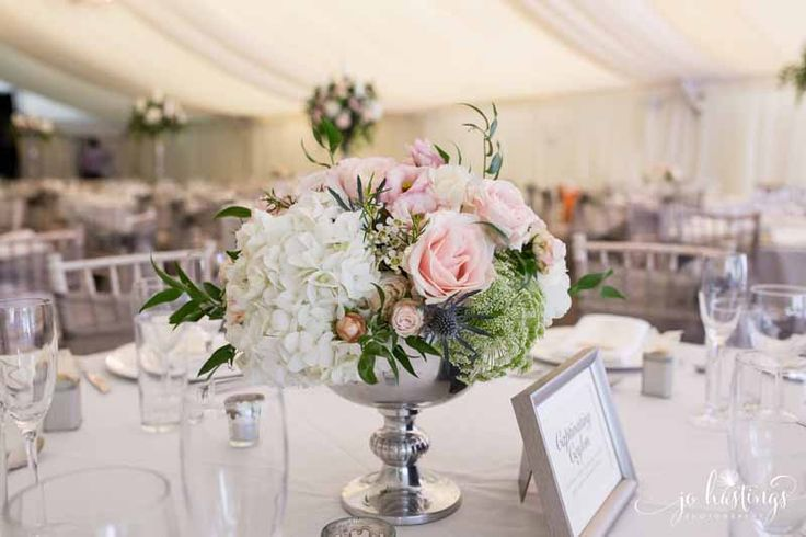 Silver footed bowl centrepieces with blush pink roses