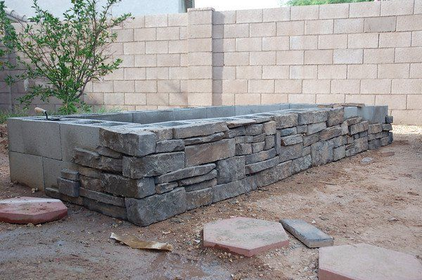 pretty – cover cinder block raised bed with thinset mortar + stone veneer