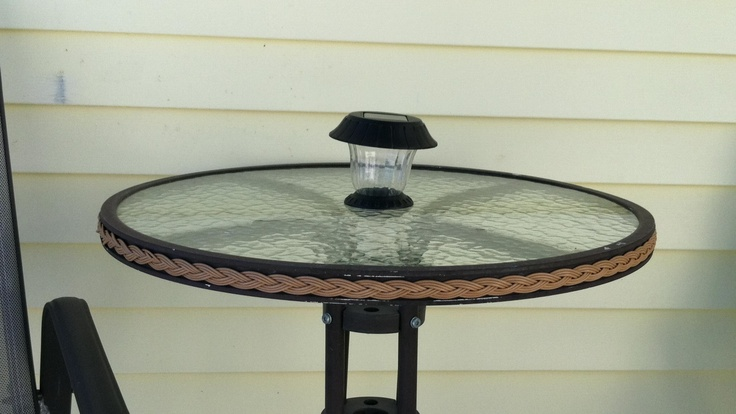 Solar light in patio table where the umbrella hole is