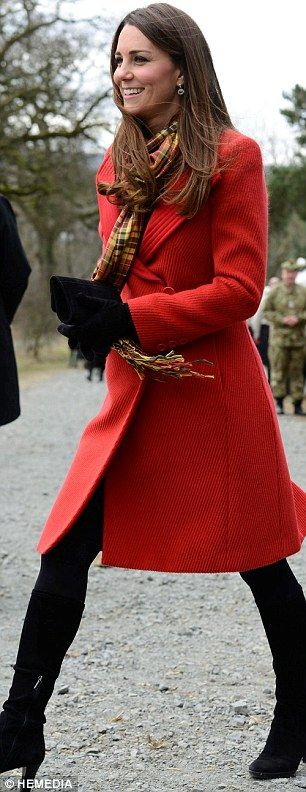 The Duchess of Cambridge wore a red Armani coat and her Strathearn tartan scarf for a visit to the new Tamar Manoukian Outdoor Centre at Dumfries House in Ayrshire today. April 5, 2013:
