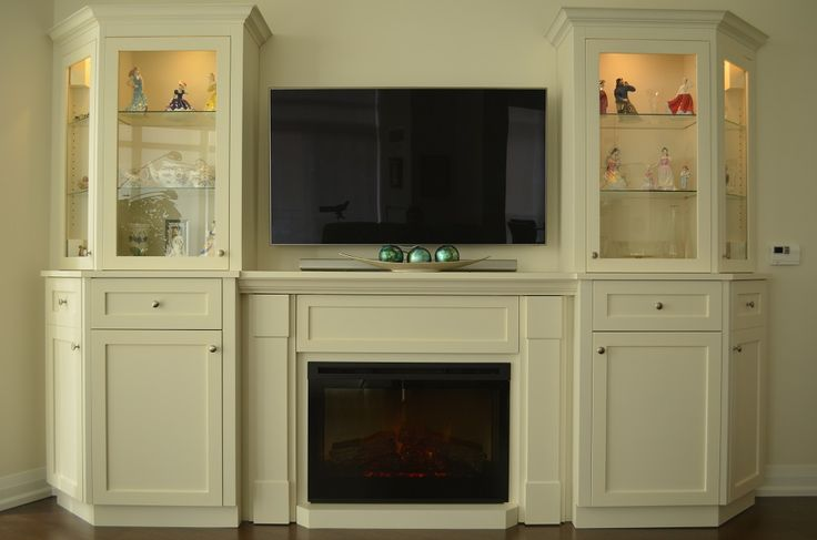 Custom wall unit with electric fireplace for a condo living room Electric fireplace insert is
