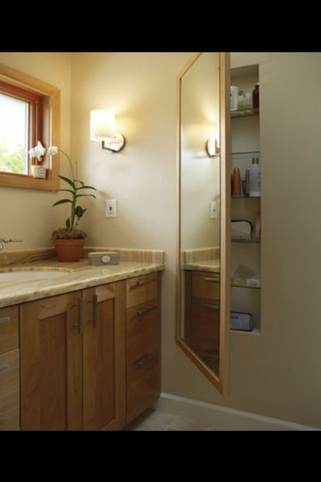 Hidden storage Mirror opens to reveal shelves between