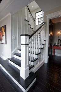 Replace carpet with dark wood floors and paint railing ...