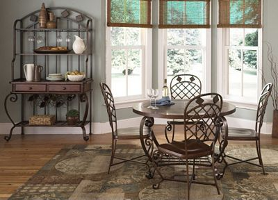 Our Edgewood Canyon dining collection is fashioned with antique copper finished metal and is