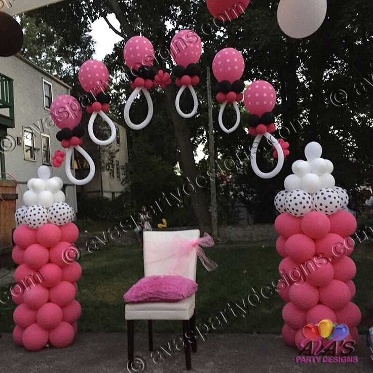 This baby shower balloon arch is designed with everything that a momtobe needsbaby bottles