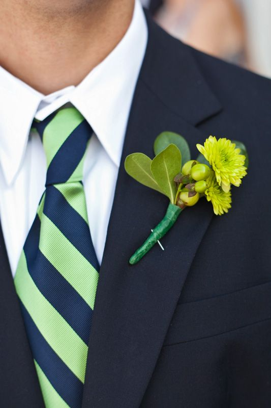 navy suit, white shirt, blue/green tie