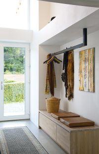 Efficient & practical entry - suspended coat rack & built ...