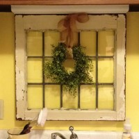 Homemade boxwood wreath over antique window frame for ...