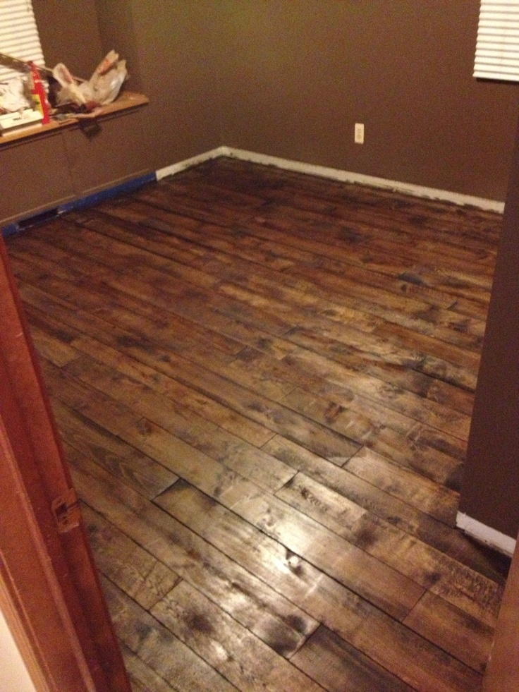 Floor made of palletcrib boards Drum sanded stained