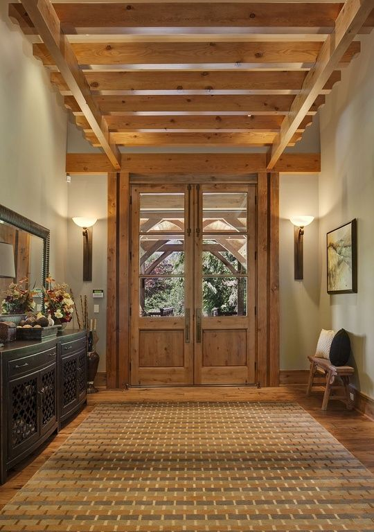 Rustic entry with French doors and beams rustic