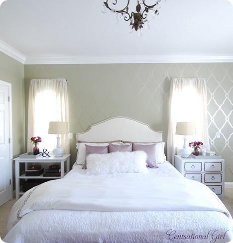 light purple and black bedroom colors. light grey walls, cream headboard, white and purple bedding, splash of black or white
