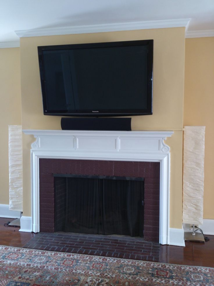 How do you mount a TV above a fireplace on a brick wall
