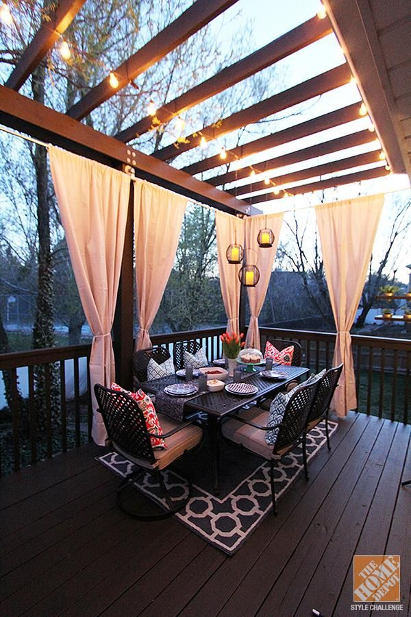 Deck Decorating Ideas: Pergola, Lights and Cement Planters