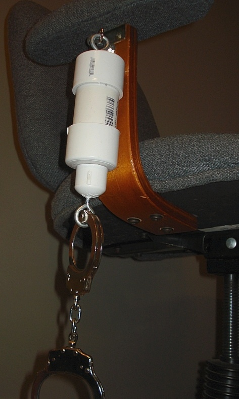 Selfbondage Ice lock attached to computer chair