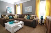 brown, gray, teal and yellow living room with sectional ...